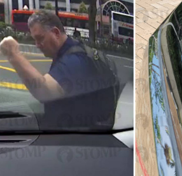 Pedestrian thumps fist on car bonnet along Scotts Road for no reason