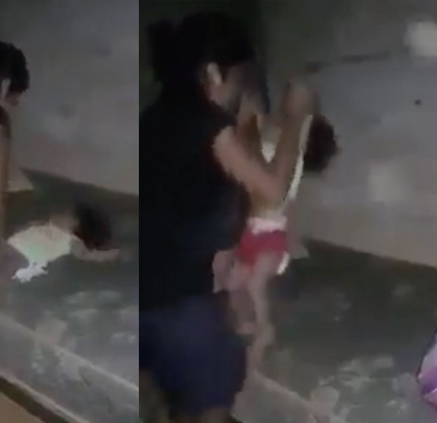 Malaysian police looking for woman filmed abusing baby