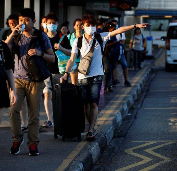 Coronavirus: Singapore scrambles to house commuting workers after Malaysia bans overseas travel