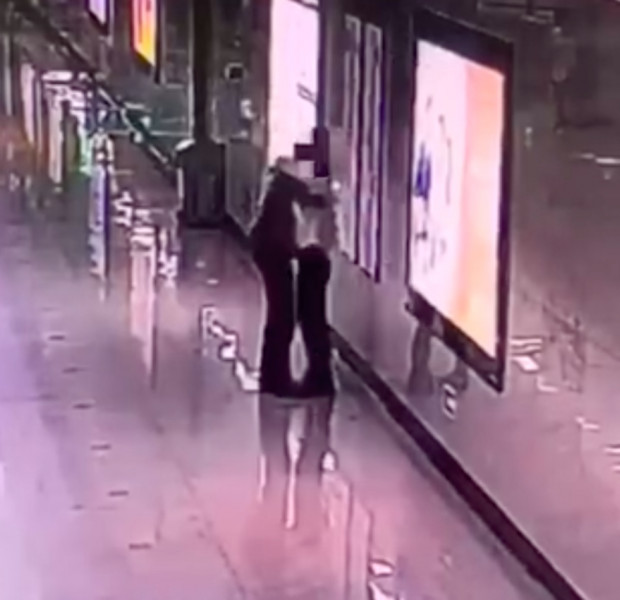 Chinese mum bawls on train station staff's shoulder because she couldn't cry at home