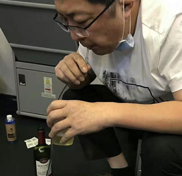 Chinese doctors save elderly man's life by sucking out his urine on long-haul flight