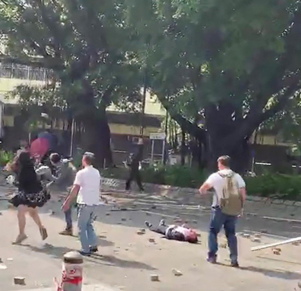Man, 70, hit on head by brick during Hong Kong clash dies