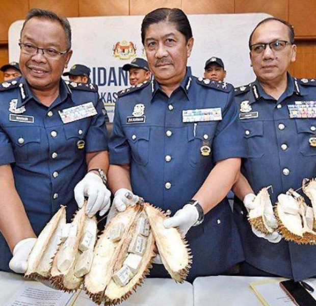 Woman caught in Malaysia trying to smuggle heroin in durians