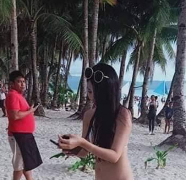 Boyfriend of Taiwanese tourist in skimpy 'bikini' pleads for netizens to stop sharing her photos