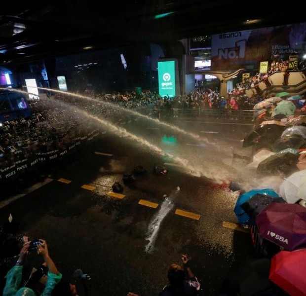 Thai police turn water cannon on defiant protesters