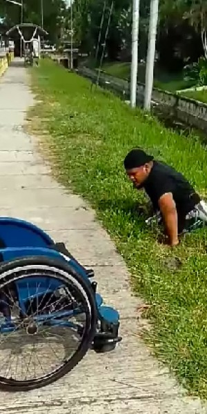 Disabled man descends steep slope to save stranded kitten in Malaysia