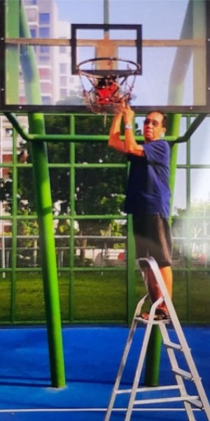 Internet lauds drinks uncle for maintaining Hougang basketball court nets for years
