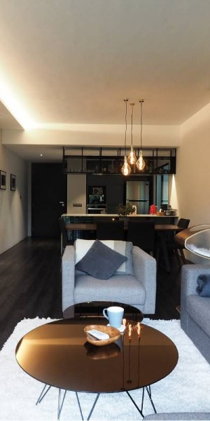 House tour: A dark-hued sanctuary of a condominium apartment in The Raintree