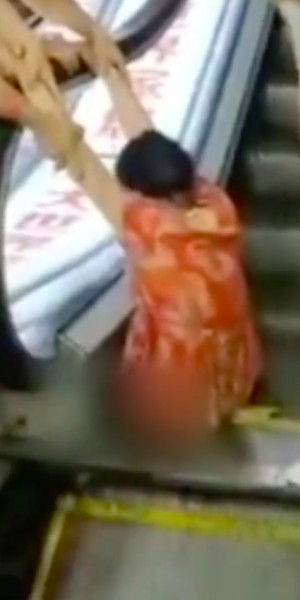 Woman in China loses leg after getting trapped in escalator, but witnesses say it was her fault