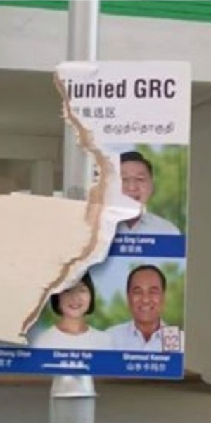 Police investigating man and teen for damaging PSP, PAP posters