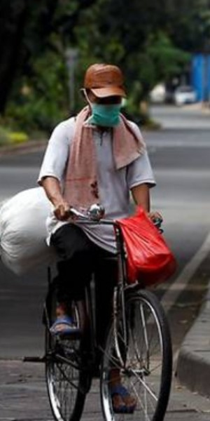 Indonesian urbanites turn to bike riding to beat cabin fever