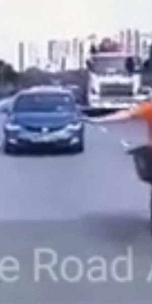 Do you see my hand signal? Cyclist cuts across lanes and collides with taxi