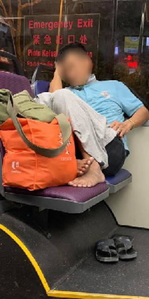 Man caught sleeping with feet on bus seat but netizens are on his side