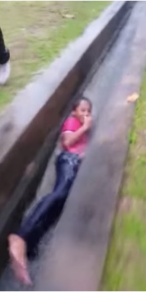 Malaysian boy turns longkang into a waterslide, his mother's not impressed