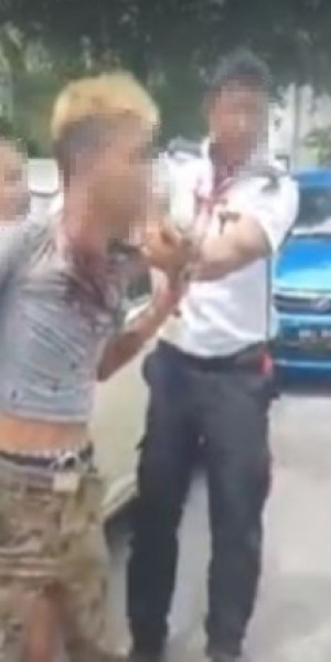 Security guard attacked for clamping illegally parked car in KL