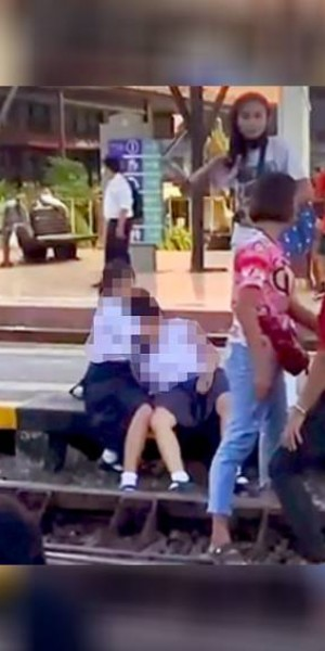 Thai schoolgirl slapped for not standing up during national anthem