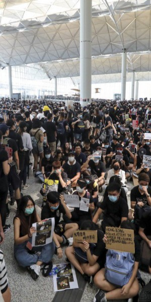 Who has gained from Hong Kong airport's record drop in passengers?