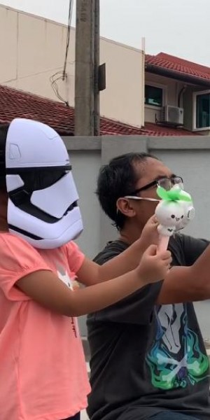No joke: Malaysian dad and daughter try to 'blow back' the haze
