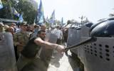 Ukraine police conscript dies in parliament clashes