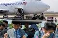Malaysia falls silent in honour of returning MH17 dead
