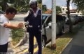 Traffic enforcer questioned for not issuing summonses to illegally parked cars
