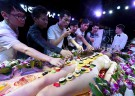 Customers in China bar eat sushi off woman's body