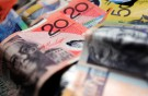 Aussie dollar falls to near parity with S$