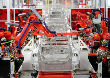 Tesla to cut 7 per cent of workforce amid tough profit outlook