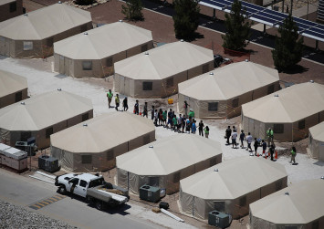 States sue Trump over immigrant families as Congress quarrels