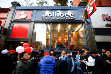 Crowds brave London chill for Philippine fast-food giant Jollibee's British debut