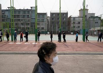 South Korea's coronavirus battle propels Moon's party to election win