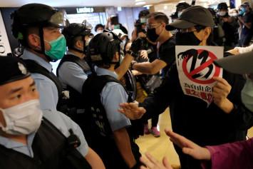 Hong Kong police break up pro-democracy singing protest at mall