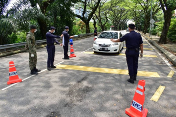 Malaysian cop at roadblock allegedly rapes 2 women