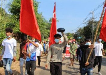 Myanmar protesters paint Yangon red, defying bloody army crackdown