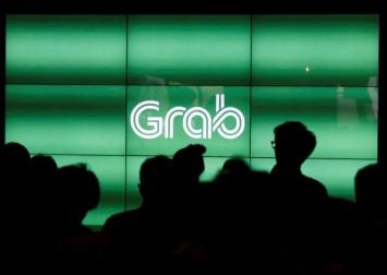 Why is Singapore's Grab different from ride-hailing giants Uber, Lyft and Didi?
