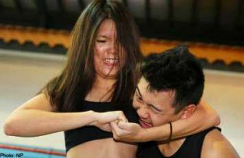 Not your ordinary girl: Singapore female pro-wrestler trounces 3 guys