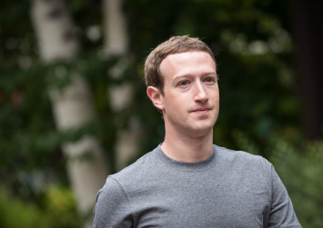 Zuckerberg admits 'mistakes' over Facebook data scandal and vows fix