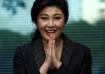 Thai ex-PM Yingluck misses verdict, arrest warrant issued: judge