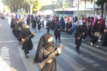 Kindergarten in Indonesia sparks backlash for dressing children in ISIS-style outfits for parade