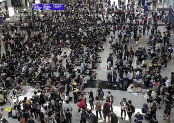 Hong Kong airport occupied by hundreds of protesters amid tightened security