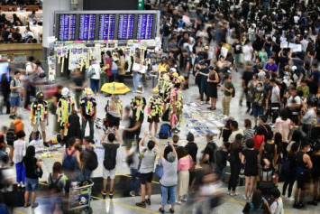 Hundreds of demonstrators rally at Hong Kong airport arrivals hall ahead of planned weekend protests