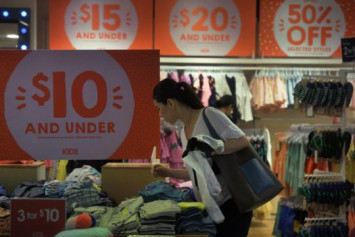 Singaporeans spending less on clothing and shoes