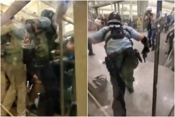 Video of cop pulling gun on Hong Kong protesters after being attacked goes viral