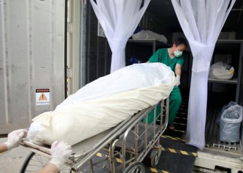 As Covid-19 cases surge, Thai hospital uses containers to store bodies