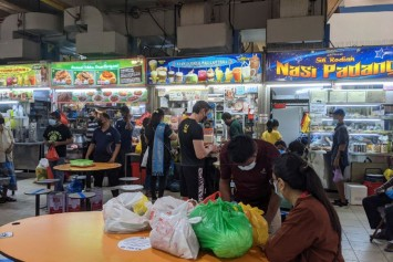 Hawkers, coffee shop patrons welcome dine-in for groups of 2 without Covid-19 vaccination checks
