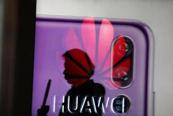 Trump says would intervene in arrest of Huawei executive if it would help secure China trade deal