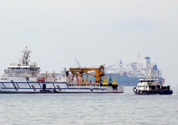 Singapore 'encouraged' by Malaysia's statement that it will de-escalate situation in maritime dispute