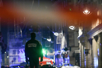 Shots, then silence at French Christmas market