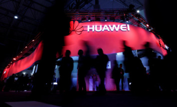 US charges China's Huawei with bank fraud, stealing trade secrets