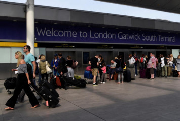 Flights suspended at Britain's Gatwick airport after reports of drones